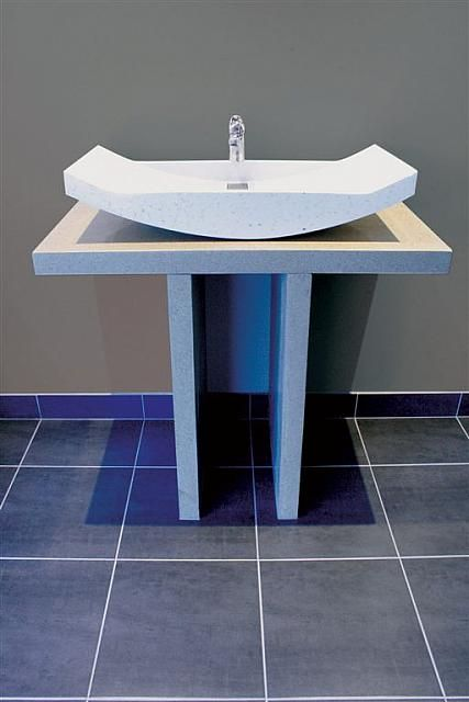 concrete-designer-hand-basin with custom stainless steel drain