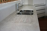 undermounted double sink with shaped drainboard